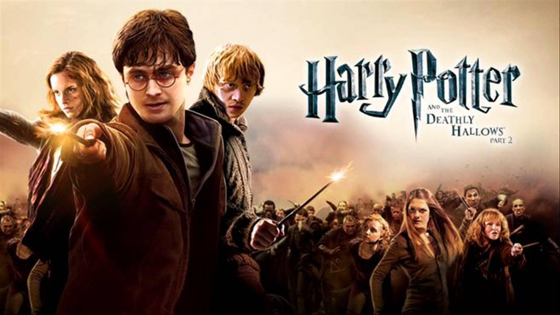 poster phần phim phim Harry Potter và Bảo bối tử thần phần 2, gồm 3 nhân vật chính cùng với bạn bè và già đình của họ ở Hogwart đứng lên chống lại Chúa tể hắc ám