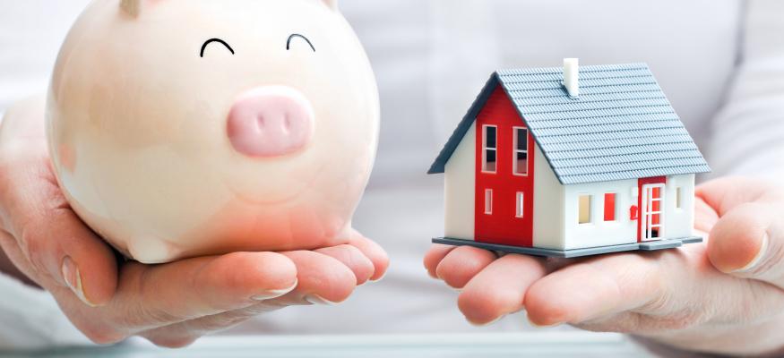 Số tiền tiết kiệm trong lợn được đặt nang bằng với một ngôi nhà - hình ảnh minh họa cho to V làm tân ngữ của động từ 1