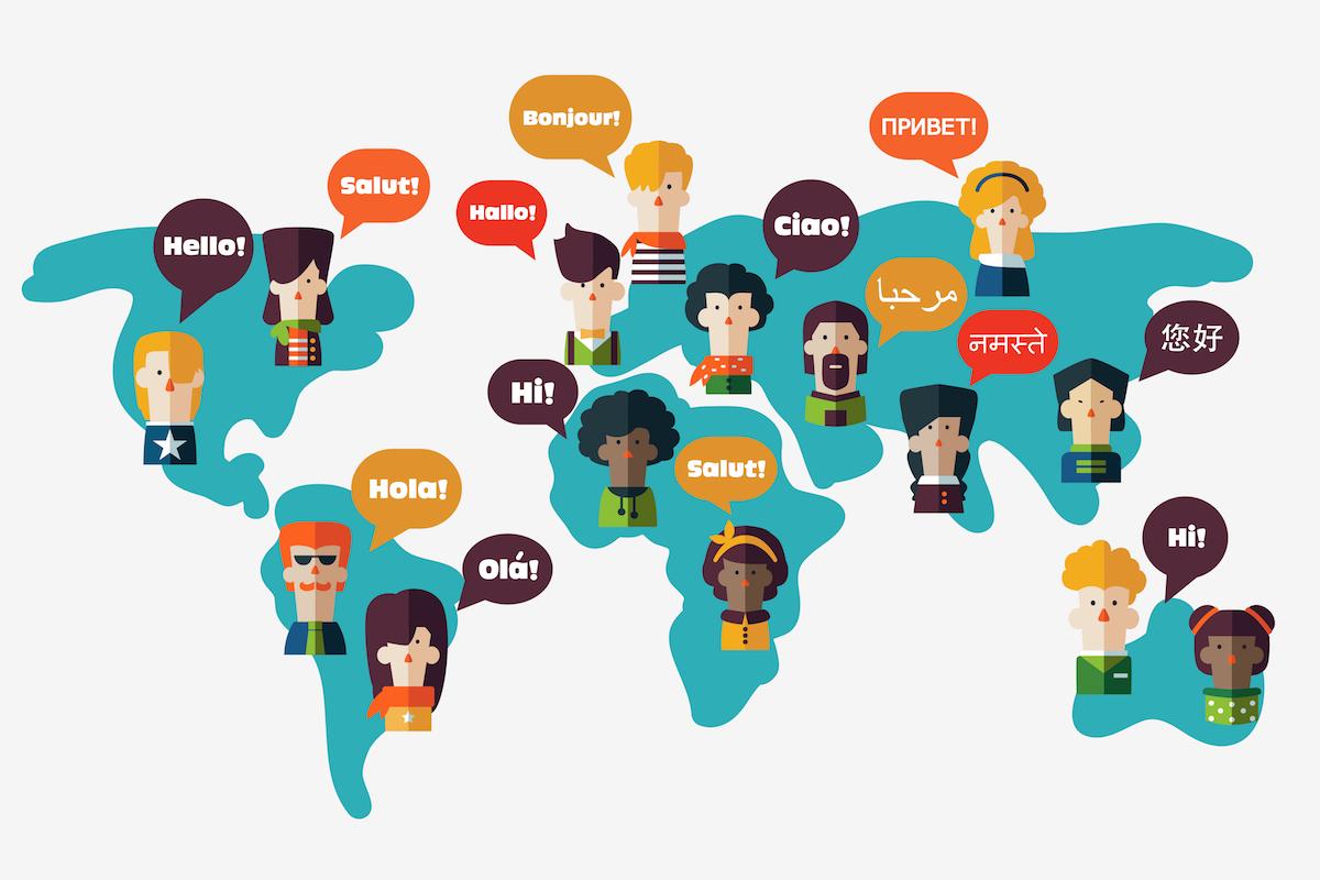 """nhiều người đang nằm trên bản đồ thế giới nói """"Xin chào' bằng ngôn ngữ của họ"""