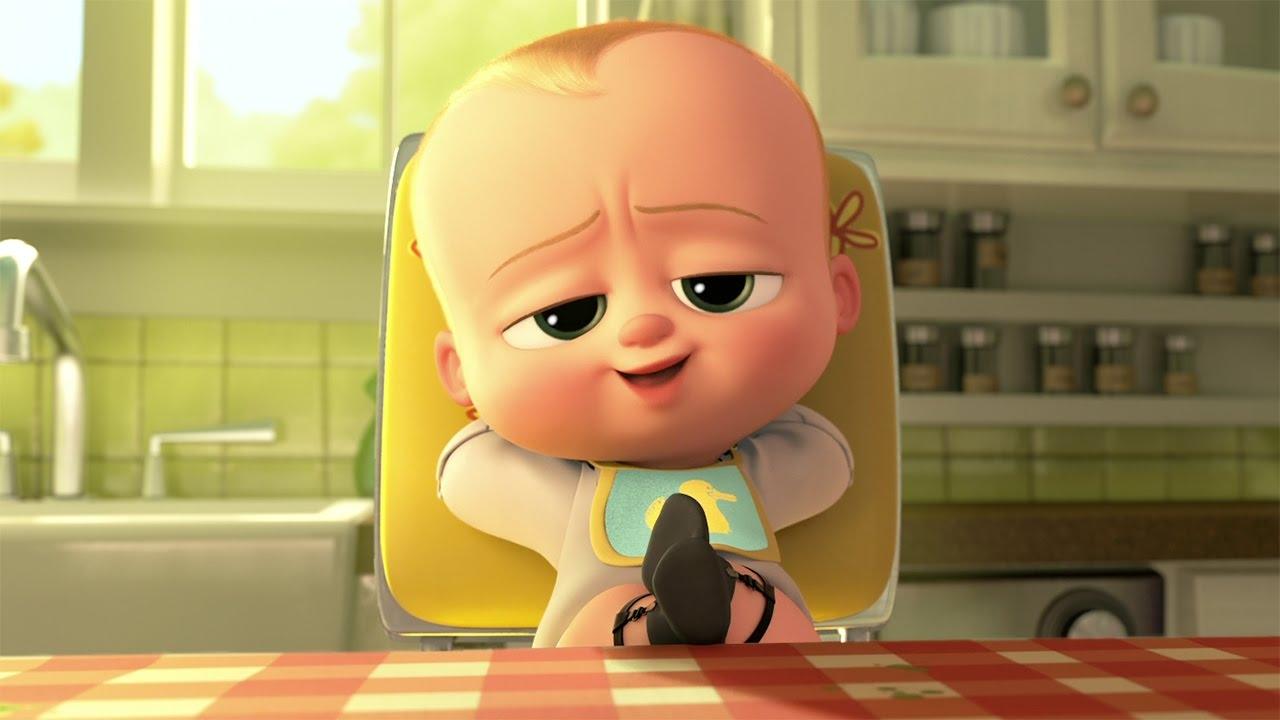 cậu bé Baby Boss đang ngồi vắt chéo chân trên bàn ăn với vẻ mặt vô cùng tự đắc - hỉnh ảnh minh họa cho bài viết về hoạt hình tiếng Anh cho bé